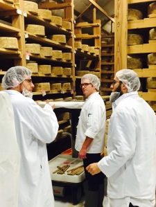 The Cheese Traveler team selecting cheeses with a cheese maker at The Cellars at Jasper Hill